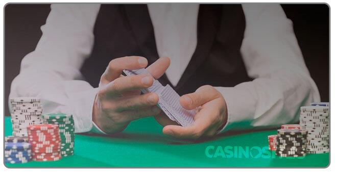 Image of casino dealer shuffling cards