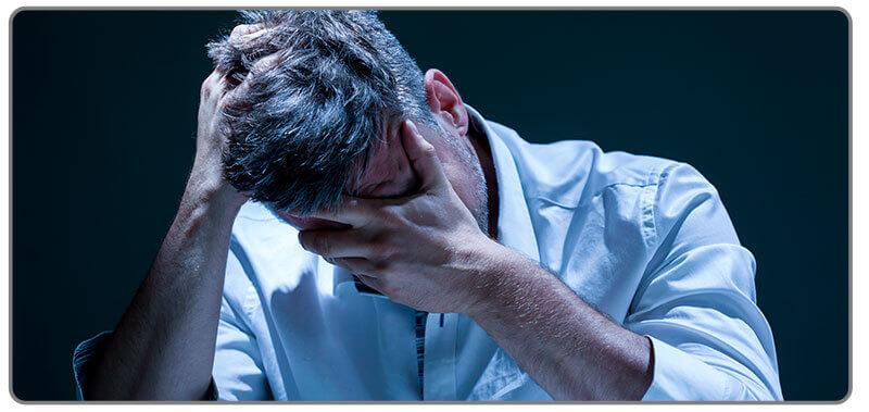 Image of sad man who chased his losses