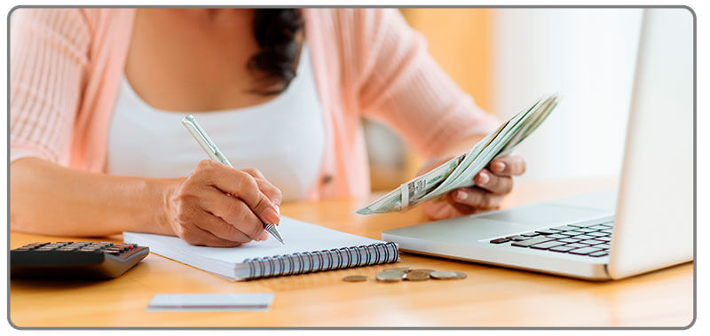 Image of woman keeping track of her bets