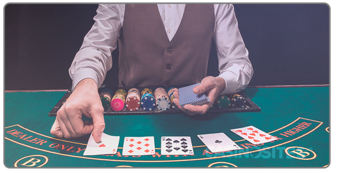 Image of Casino Dealer dealing cards to players